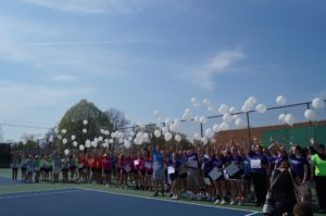 Players release white balloons