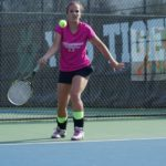 Tennis player hits forehand