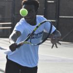 Player keeps eye on tennis ball